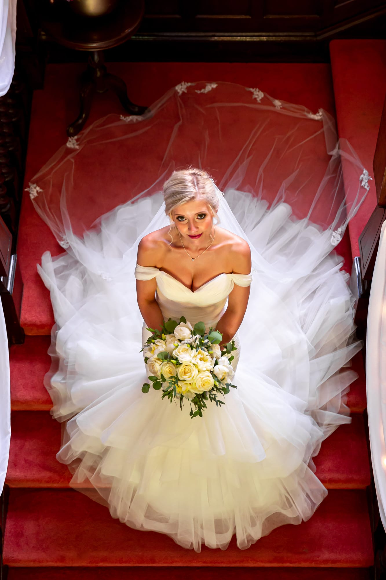 Bride on stairs looking up