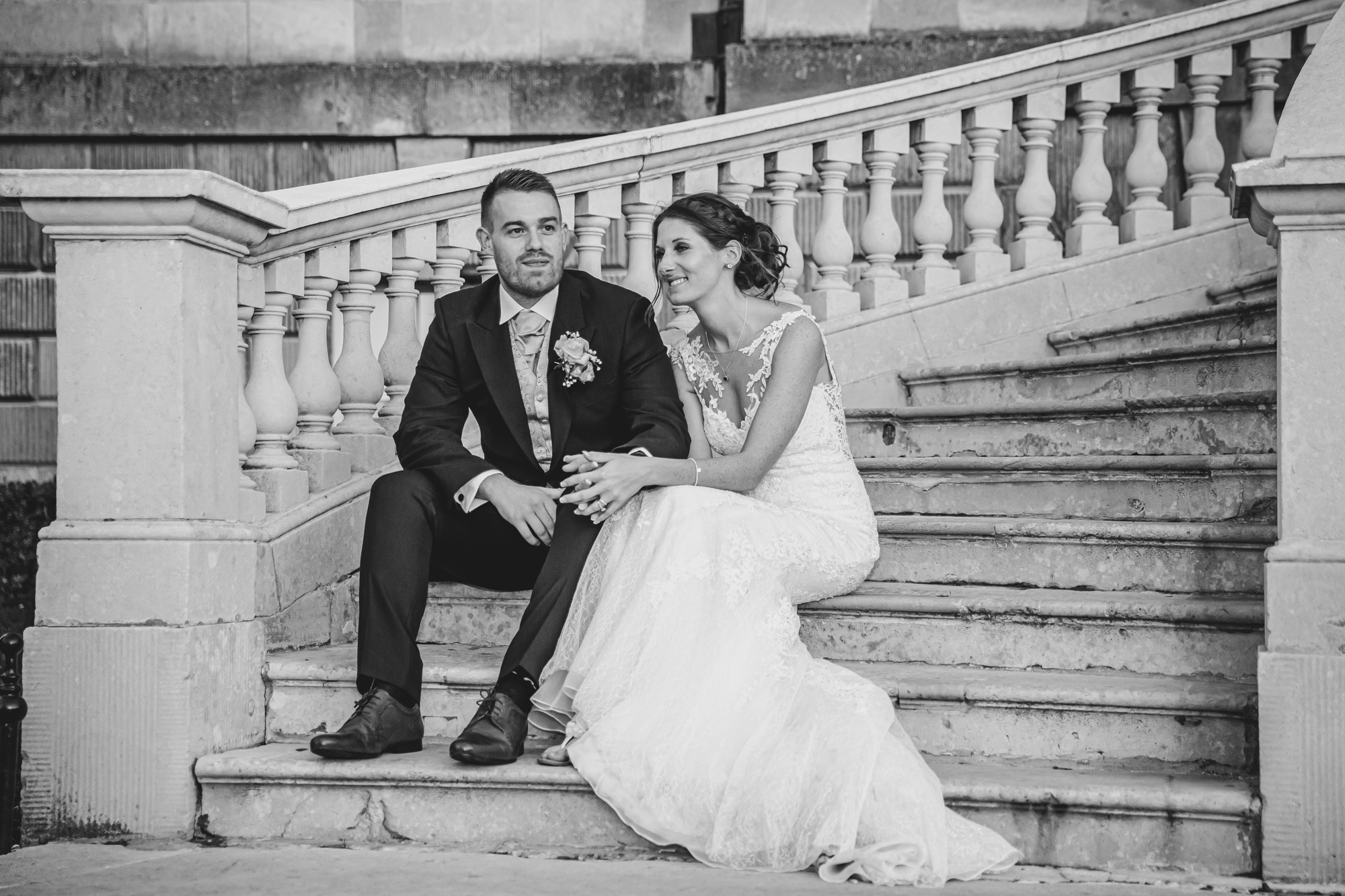 Bride & Groom on steps sharing a quiet moment